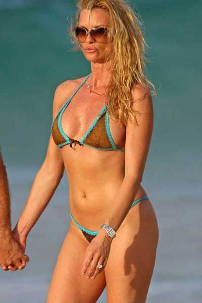 Now the tough question of the week - Which bikini does Nicolette Sheridan ...