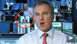 Banker Caught Looking at Topless Girl on Live Television