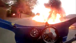 Motorcycle Racer Blows Through a Fireball Like It's Nothing