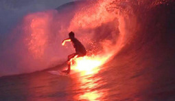 Indonesian Surfers Take Fire for a Ride